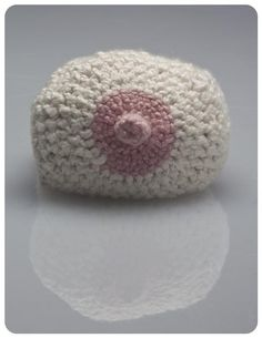Handmade baby beanie that resembles what baby's breast feeding head is hiding.