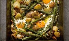 Hugh Fearnley-Whittinstall's roast new potatoes and asparagus with baked eggs: a frittata-without-palaver. Photograph: Colin Campbell for th...
