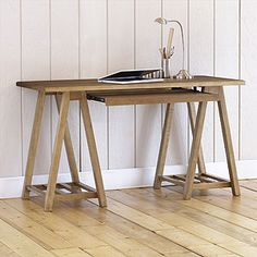 ~World Market Charles Sawhorse Desk, Natural: $150.00 (with discount) http://www.worldmarket.com/product/index.jsp?productId=4023924   Discount: ~World Market: 25% off all furniture with coupon code: NOVFURN7 Printable Coupon: http://www.worldmarket.com/category/index.jsp?categoryId=3846461&ab=home:wk40:a:coupon
