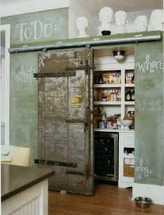 Chalkboard wall in the kitchen, mixed with a rustic door.
