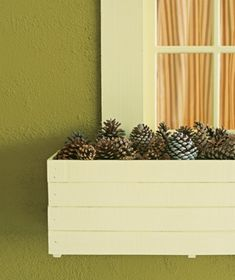 Once your flowers are done for the season, fill window boxes with pine cones for a no-maintenance display.