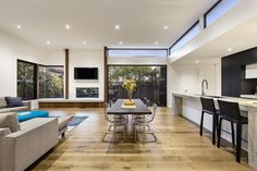 No walls separate the rooms in this space suggests a very open space, however the dining table is central to the room