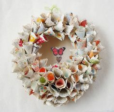 DIY paper rosette wreath. Could also make only out of newspaper.