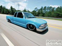 """Daniel Callahan admits that are a dime a dozen, but his """"'lil blue bastard"""" 2000 Chevy is clean, simple, and has been built to tear up the highway, in Mini Truckin' Magazine. Lifted Silverado, Lifted Chevy Trucks, Chevrolet Trucks, Bagged Trucks, Mini Trucks, Custom Trucks, Custom Cars, S10 Truck, Lo Rider"""