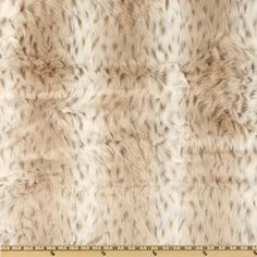 Faux Fur Snow Leopard White/Taupe from @fabricdotcom  Take a ride on the wild side with this safari inspired faux fur fabric.  Fur has about a 1'' (25mm) pile,  a luxurious hand and a soft subtle sheen just like real animal fur!  Make gorgeous jackets, coats, wraps, fashion accessories, pillows, throws and more!