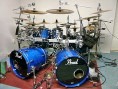 Huge Pearl drum kit.  Two questions come immediately to mind -- how much does all that cost, and how long would it take to set up when you moved it?!?!