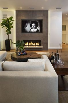 Kamin Wohnzimmer Modern Modernes Wohnzimmer und Kamin How An Area Rug Can Make The Perfect Room Acce Linear Fireplace, Home Fireplace, Living Room With Fireplace, Fireplace Design, Fireplace Modern, Fireplace Ideas, Tv With Fireplace, See Through Fireplace, Christmas Fireplace