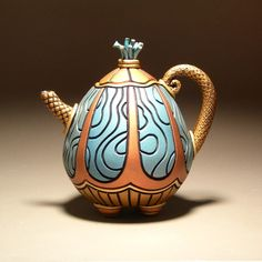 [handmade, sculptural, clay tea pot. ]