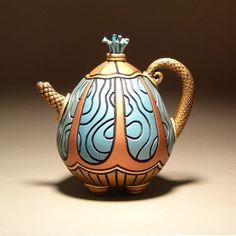 [handmade, sculptural, clay tea pot. ]