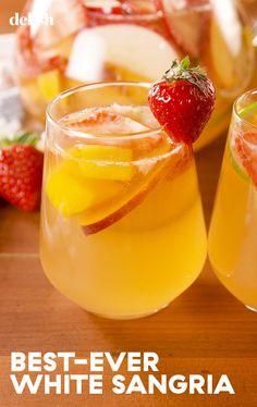 1 c. sliced strawberries 1 mango, cubed 1 peach, sliced 1/4 c. granulated sugar 1/4 c. Grand Marnier  1 apple, sliced 1 orange, sliced  1 lime, sliced 1 (750-mL) bottle white wine, chilled  1 c. seltzer