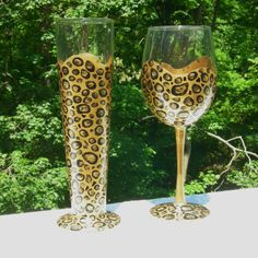 Hey, I found this really awesome Etsy listing at http://www.etsy.com/listing/74789631/leopard-hand-painted-wine-and-beer