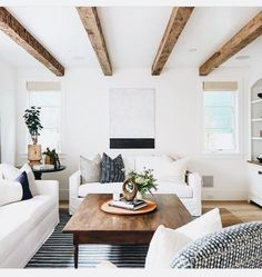 Subtle dark accents in the pillows and area rug make this white space pop in a quiet way