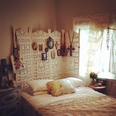 I have the exact same room divider used as a headboard as well. In it's natural wood. Like the airy white.