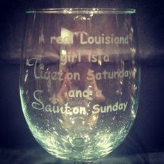 A Real Louisiana Girl is a Tiger on Saturday and a Saint on Sunday handmade wine glass by 1325UniqueCustomGift on Etsy https://www.etsy.com/listing/203088813/a-real-louisiana-girl-is-a-tiger-on