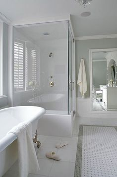 Galley-Style Full-Service Bath-This remodeled 15x12-foot bathroom combines the basics -- sink and toilet -- with the luxury of a separate tub and shower in a relatively compact space. The corner shower and freestanding tub occupy one wall, leaving space at the end of the tub for freestanding storage.  On the opposite wall (visible here in the mirror to the right of the shower), built-in cabinetry encompasses a sink, dressing table, and storage. The toilet fits into the corner beside the…