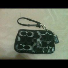 SOLD!!Coach Black Op Art Wristlets Silver Metallic Coach black wristlets with large black and silver C's. Coach Bags