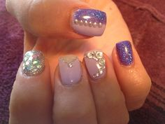 Purple and silver nails with bling and studs