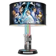 Star Wars Original Trilogy Lamp With Illuminated Lightsabers - Star Wars Ewok - Ideas of Star Wars Ewok - First-of-a-kind lamp's barrel shade showcases acclaimed Steve Anderson Star Wars art. Flip a separate switch and lightsabers glow blue green and red! Decoration Star Wars, Star Wars Decor, Star Wars Art, Star Wars Jedi, Theme Star Wars, Star Trek, Star Citizen, Star Wars Bedroom, Star Wars Nursery
