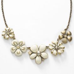"""Antique Flora Necklace - Sand Opal crystal and Powder Almond crystal pearls; Cream epoxy; oxidized brass plating; 16"""" to 19""""."""