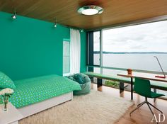 In a child's room of a Mercer Island, Washington, lake house  the walls are painted in Benjamin Moore's Capri Seas.