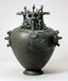 Bronze hydria imported from southern Italy, around 570 BC. AD, with representation of the Mistress of the animals. Etruscan. Bern Historical Museum (Bernisches Historisches Museum), Bern.