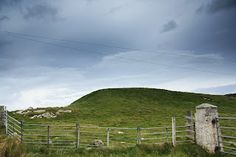 Sithean Mor which translates to mean 'The Large Fairy Mound' on the Island of Iona. Fairy mounds, also known as 'raths', dot the countryside of Britan, Scotland and Ireland. A path that is said to be frequently used by the wee folk is also referred to as a fairy rath,