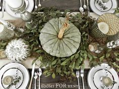 Designing a fall color pallet around blue and green squash and pumpkins, oak leaves, burlap, and rustic wood.