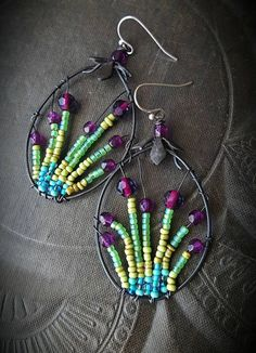 Hey, I found this really awesome Etsy listing at https://www.etsy.com/listing/510738796/flowers-wire-wrapped-hoops-artisan-made