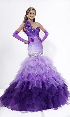Love tHe shape, not the color  Mermaid dress with full ruffled skirt.