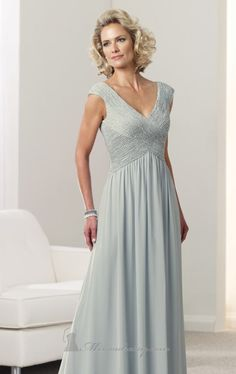 Be the star of the night with an elegant, floor length evening gown designed by Mon Cheri Montage 112916. This non-slit evening gown is the perfect piece for any formal occasion. This dress, made using chiffon fabric, is grand in its own right with its cap sleeves, ruched criss cross bodice and V-shaped cut for the neckline and back. It has an inverted basque design for the waist and also comes with a matching shawl should you feel the need to warm up a little bit.