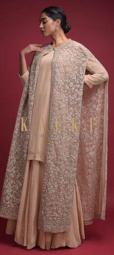 Buy Online from the link below. We ship worldwide (Free Shipping over US$100)  Click Anywhere to Tag Nude Beige Palazzo Suit In Georgette With A Long Cape In Floral Jaal Embellished Net Online - Kalki Fashion Nude beige palazzo suit in georgette.Crafted with round neckline and 3/4th sleeves.Topped with a matching long cape in net. Anarkali, Lehenga, Salwar Kameez, Kurti, Designer Wear, Designer Dresses, Long Cape, Palazzo Suit, Straight Cut