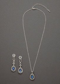 The definition of regal elegance, you will feel like a princess in this gorgeous set! This breathtakingly beautiful necklace and earring set features stunning silver and blue rhinestones. Drop earrings have a delicate twist design for the perfect finishing touch. Available in Silver. Imported.