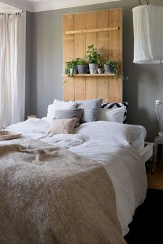 Untypical headboard with small potted plants