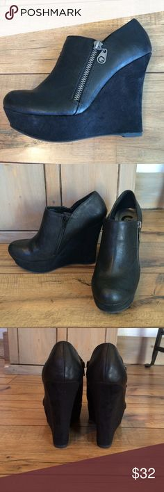 Guess wedge booties Excellent condition, only worn twice. 4.5 inch heel. Platform sole. All man made materials. Heel and platform has faux suede finish. Decorative zipper on the outside and real zipper on the inside. Guess Shoes Ankle Boots & Booties