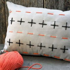 It's amazing how something as simple as a stitched pillow cover can give your room a new look in an instant!