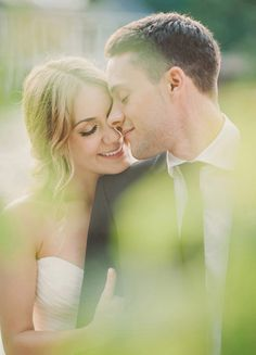 romantic and intimate wedding photos shooting through objects like trees, flowers, or bushes to create that softer depth of field.