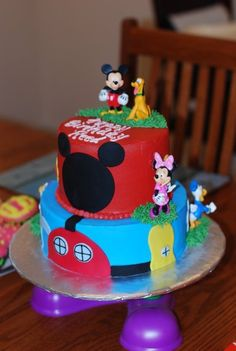 A Mickey  Mouse cake!  My daughter was raised on Mickey, starting with her Nursery!  She loves the Mickey World now, also!  Her nickname is Mikki!  :)