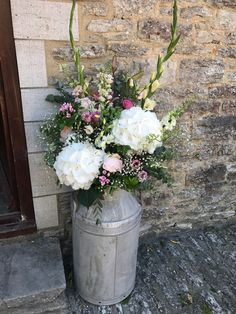 Milk churn vintage flower arrangement including larkspur, hydrangea, rose, gypsophila. Made in the UK by www.meadowsweet.co.uk