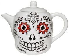 LUCKY SKULL PORCELAIN TEA POT  Enjoy some cookies with a lovely cup of tea from the Lucky Skull teapot! This white porcelain teapot features a decorative, grinning sugar skull on one side. Sit this in your kitchen for a little added Mexican kitsch!  $25.00