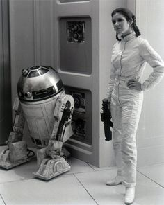 Artoo Detoo and Carrie Fisher on the set of The Empire Strikes Back, 1979.