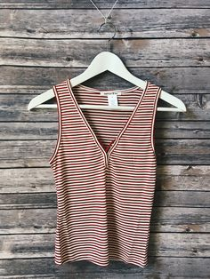 """This ribbed knit stripe top features short sleeves, a scoop neckline and a relaxed fit. Description: L: 22"""" B: 30"""" W: 28"""""""