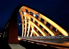 Bridge at night - Commissioned by the province of Fryslân, we designed two wooden traffic bridges in Sneek in collaboration with Onix under the name OAK (Onix Achterbosch Kunstwerken). The bridges connect two districts on either side of the A7. They are designed as a new city marker on the highway.