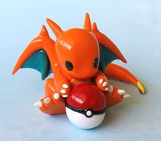 Just try and catch this Charizard! This figure is completely handmade with polymer clay and glazed for a nice shine. - The dragon is about 1 inch tall, 2 inches wide, and 2.5 inches long from head to tail. - This item is meant for display only! - Please do not expose the sculpture to water. - The color may vary slightly from what is shown.