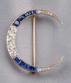 Art Deco Sapphire, and Diamond Crescent Brooch, set with old European-cut diamonds, and calibre-cut sapphires, platinum-topped 18kt gold mount, lg. 1 1/4 in.