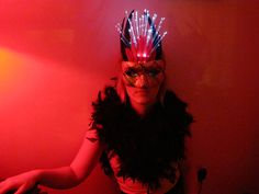 Masquerade mask by Team Rainbow Designs, adorned with feathers and white fiberoptic lights. All items come with an extra set of batteries.    For custom orders, email info@teamrainbowdesigns.com. $36 #masks #masquerade #lights #accessories #feathers #fiberoptic