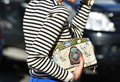 Stripes and patterned beaded clutch.