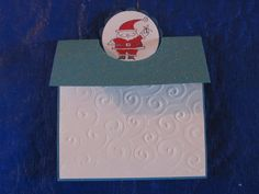 My Gift Card holder /card . Using my cuttlebug embossed  swirls using some glitter paper and stamped Santa. simple but adds a cute personal touch  to that special someone