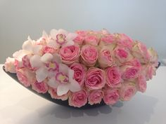 Custom rose and orchid arrangement created at the CHD boutique!