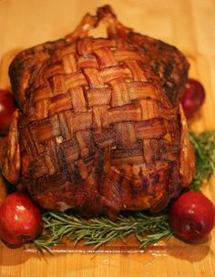 bacon wrapped turkey. not only is it decorative but it is suppose to keep the meat super moist and tasty. i have heard about this and cannot wait to try it !!