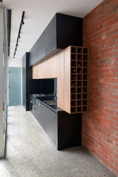 This modern wood wine rack is built-in to the cabinets of this kitchen, creating the perfect storage system.